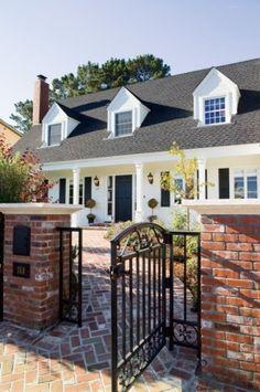red brick, black roof & white siding/trim