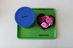 Dropping coins in a container This is a really fun activity for Sweet Girl!  She does this one multiple times each day.  And it's so easy to make too!