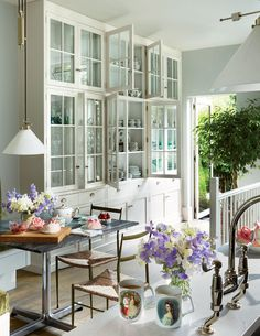 The kitchen, stocked with porcelain by Herend, opens onto an evergreen garden.