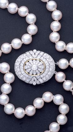 """Double strand Japanese akoya pearl necklace with diamond clasp in pt. and 18k yg. Strands of 9.5 mm - 9 mm pink rose pearls, good luster and match. Detachable oval clasp set with 2.24 cts circular- and baguette-cut diamonds, can be worn as brooch. Strands: 17"""" - 16"""", clasp/brooch: 1 1/4"""" x 1 1/2""""."""