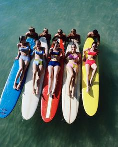William Connors photographs 5 models in multi-coloured Jantzen bikinis on surfboards in 1966.
