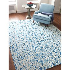 Our spot on the Catwalk pure wool rug features an on-trend animal design in blue or gray.