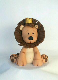 King of the Jungle fondant cake topper. He is a Large topper that is 5 wide, 3 deep and 5 1/2 Tall. He will sit beautifully on any size cake. All items are handmade with gumpaste and fondant mixture. Please remember every topper is hand made and colored to ordered and no two will be exactly alike . Everything I make is out of a fondant and gumpaste mixture. Because it is made with gumpaste your product can last for years to come if stored properly. You can keep your cake topper to remem...