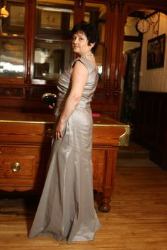 Chris wearing this beautiful evening gown in silver grey from Vera Mont, stunning necklace by Butterfly