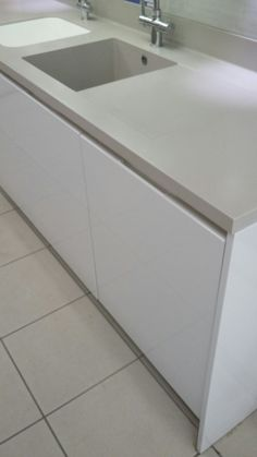 By Design Baden Kitchen on display in our Walton-On-Thames Showroom with Corian worktops and moulded sink