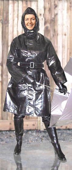 Happy lady in her black rainwear