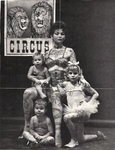 Tattooed circus family from the turn of the 19th century