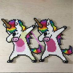Made dabbing unicorn perler bead sprites because how could I not. Original photo was a t shirt design and it has a shadow I wasn't sure about. So I made one without the shadow as well. Which do you like better? Perler Bead Designs, Hama Beads Design, Diy Perler Beads, Perler Bead Art, Pearler Beads, Fuse Beads, Pearler Bead Patterns, Perler Patterns, Modele Pixel Art