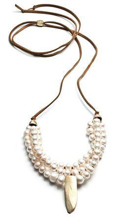 """Three strands of AA quality fresh water pearls with recycled brass on ultra suede SIZE: 1"""" drop  LENGTH: 16"""" - 27"""" Please allow 1-2 weeks for delivery. Hand made in NYC."""