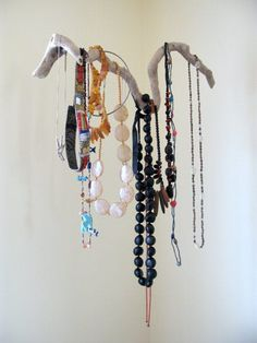 We've seen some wonderful and inventive jewelry storage solutions on Apartment Therapy over the years, but this elegant display that appears to float weightlessly in the air — spotted while photographing an upcoming Little Compton, Rhode Island house tour — stopped me in my tracks for its surprising beauty.