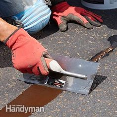 Add trowel mix and then smooth it - Asphalt Patching and Crack Repair: http://www.familyhandyman.com/masonry/asphalt-patching-and-crack-repair/view-all