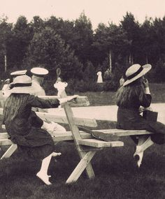 Grand Duchess Anastasia, left, with her older sister Grand Duchess Maria. Their father, Nicholas II, is seen in the background.