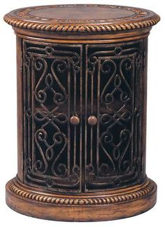 New Side Cabinet Product DetailsDimensions (inches):30H x 24W x 19DComment:Complete with meticulously forged iron work, beaded sides, a hand-tooled leather top, and a rich mahogany finish.Date:NewMate