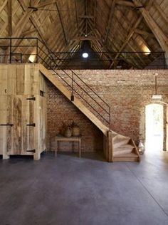 Instead of having upstairs, just have brick wall divider. Hallway on each side; ride hallway for groom; left hallway for bride. Each hallway leads to atrium. From hallway/bride, grooms suite a secluded outdoor porch/grass area. Loft House, My House, House Wall, Converted Barn Homes, Barn Renovation, Farmhouse Renovation, Outdoor Stairs, Brick Flooring, Brick Wall