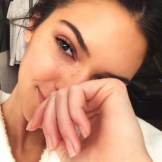 The rising model took to Instagram on April 26, 2015, when she shared a photo of herself without a stitch of makeup, revealing her adorable sprinkling of freckles. She captioned the snap with two emojis: a baby face and an alien face.