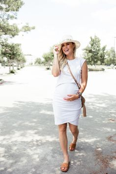 32530563db Houston fashion blogger Elly Brown wears a Bae The Label maternity dress  for the summer with