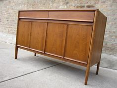 I love mid century modern furniture.  I want a buffet like this for my dining room but painted white and lacquered.