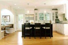 White kitchen, dark island, nice upper cabinet relief