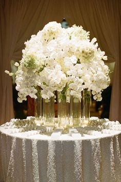 This elegant centerpiece containing orchids, hydrangeas and tulips drips with elegance.