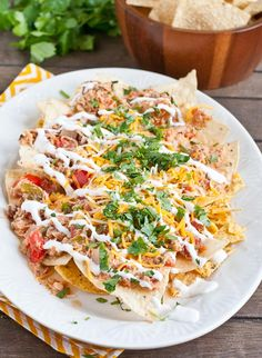 Chicken Chilaquiles are a spicy take on nachos you can make in the crock pot!
