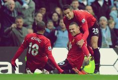 Ashley Young, Wayne Rooney and Robin van Persie, Manchester United FC.