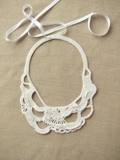 Crocheted necklace, made of white yarn and white beads. This necklace is one of a kind, made in freeform technique. Closure with double-faced satin ribbon. This necklace can be worn at both casual wear and special accasions. It measures approximately 6x8 (15x20 cm) at its longest points.