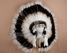 This beautifully hand stitched war bonnet is the perfect focal piece for any Native American or southwestern decor.