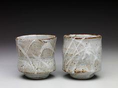 Randy Johnston yunomi, nuka glaze with iron slip and wax resist brushwork, stoneware