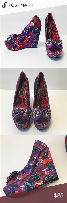 "Iron Fist satan wedges. Funky & unique Satan wedges with blue/red/purple design and purple bow with silver studs and glitter. Super cute and different. Great condition. 5"" heel. Could fit a size 6. Iron Fist Shoes Wedges"