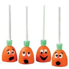 Why not make this quartet of quirky brownie pop jack 'o lanterns for all your guests. Delicious brownies on a stick, covered with icing and decorated with any facial look you wish. You can even make them resemble some of your guests just for fun.