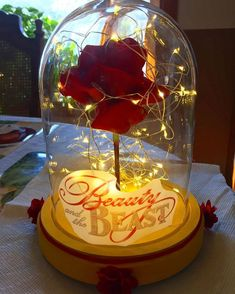 Beauty and the beast glass rose center piece diy beauty and the Beauty And The Beast Rose Diy, Beauty And Beast Birthday, Beauty And Beast Wedding, Beauty And The Best, Beauty Beast, Diy Beauty And The Beast Decorations, Disney Princess Party, Princess Birthday, Quinceanera Decorations