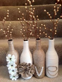 To make a couple of extra ordinary vases for your home interior, you can again resort to the sisal rope. Apparently this is just an ordinary stuff, but if you use it in a smart way, you can really make wonders with it. Like here we just wrapped the glass bottles all around with sisal rope and filled them with artificial fillers.