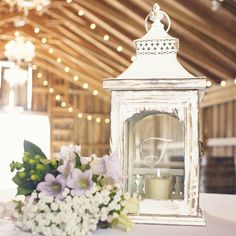 Sweet and rustic, this centerpiece lantern will add ambiance and whimsical charm to your wedding table decor. The romantic lantern is crafted from fir wood with a beautifully detailed metal top.