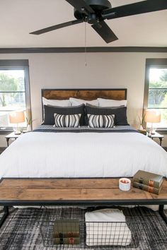 The master bedroom of the newly renovated Ridley home features a custom made headboard and bench and a wall was removed to increase the size of the room, as seen on Fixer Upper. (after)