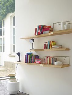 TOLBIAC  WALL SHELVES. Quirky twisted shaped shelves finished in oak or black stain.   Small W 120 x D 18/31 cm  large W 200 x D 21/35 cm  Optional metal 'frame' to show off and highlight objets (to use on large shelf only)