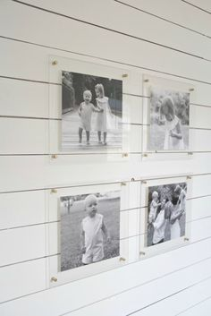 black and white family photos in acrylic frames