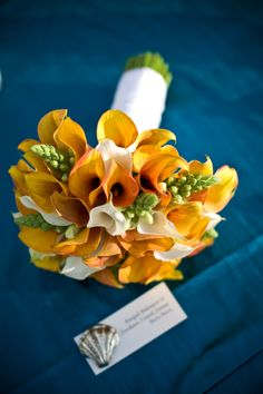 Understated elegance in this orange, white and green bridal bouquet  Bridesmaids maybe
