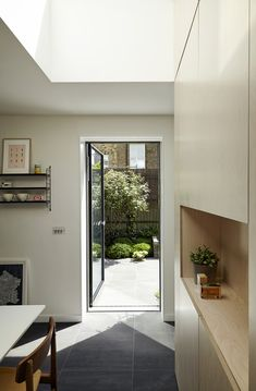Architects builds grey-brick house around three small courtyards Grey Brick Houses, Small Courtyards, Home Reno, New Builds, Small Spaces, Kitchen Design, New Homes, Floor Plans, Architects