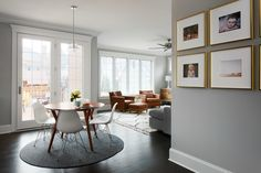 """In the breakfast nook, Eames chairs surround a simple <a href=""""http://www.westelm.com/products/parker-mid-century-round-dining-table-h303/?pkey=cdining-tables%7Coval-round-tables%7C&cm_src=dining-tables