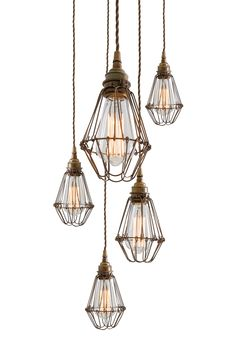 Edison-style filament bulbs, the Praia Cage Pendant Light Cluster can easily blend into any modern environment.   A trendy industrial cage cluster pendant light, perfect for a bar or stylish restaurant.   #cagelighting #clusterlight #clusterdesign #pendantlight #restaurantlight #lighting #ceilinglight #bulbpendant #rusticlighting #industriallighting