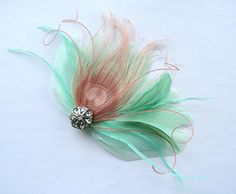 Oh Lucy Handmade IVY Peacock Feather and Crystal Veil Hair Clip Feather Fascinator Bridal Hair Piece in Mint Green and Blush Pink -- Click image to review more details.