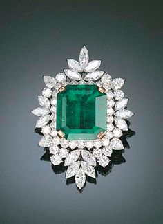 Emerald and diamond brooch. Set with a cut-cornered rectangular-cut emerald in the pear-shaped, marquise and circular-cut diamond cluster surround, mounted in white gold, cm high Emerald Jewelry, Diamond Jewelry, Diamond Rings, Emerald Rings, Ruby Rings, Solitaire Ring, Silver Jewelry, Antique Jewelry, Vintage Jewelry