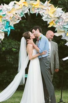 Love, love, love this paper pinwheel wedding altar. So fun! {Photo by Brandon Chesbro via Project Wedding}