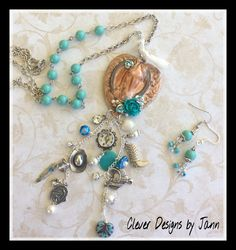 Country Chic Handmade Cowgirl Charm Necklace Set .. A Heart Component, Horseshoe Head, Resin Roses, Lot's Cowgirl Charms, Pearls, Rhinestones. Glass Beads, A Touch Of Lace, Silver Chain and Turquoise Beads .. matching earrings .. Perfect Pearls was used to colorize the rose .. FOR SALE $52.00 .. https://www.etsy.com/shop/CleverDesignsbyJann