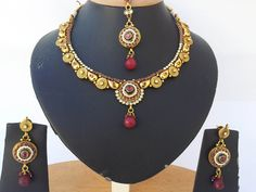 Indian costume jewelry with Ruby and clear stones Polki set-08PLK201  http://www.craftandjewel.com/servlet/the-1615/Indian-costume-jewelry-with/Detail