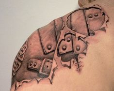 Ripped Skin Armour Tattoo