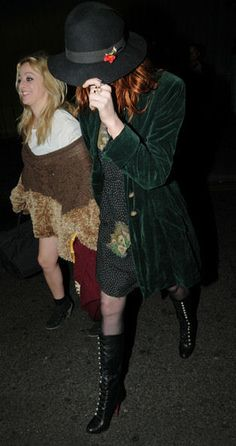 Florence Welch and Isabella Summers of Florence + The Machine. Welch is wearing a dark green vintage coat and Louboutin boots.