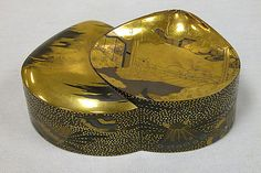 """Incense Box (Kôbako) with Scene from """"His Perfumed Highness"""" (Niou no Miya), chapter 42 of the Tale of Genji  Period: Edo period (1615–1868) Date: 19th century Culture: Japan Medium: Gold maki-e on lacquered wood Dimensions: H. 2 in. (5.1 cm); W. 2 7/8 in. (7.3 cm); L. 5 1/8 in. (13 cm) Classification: Lacquer"""