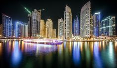 """Dubai Marina Night Cruise - Impressions from Dubai Marina at Night. You can walk the whole circumference of that Marina. It's a several kilometers walk. Because of the water and the high rises blocking the view to the 'real world' outside, you could almost forget where you really are. Almost...  Prints are now available for all of my images. Head over to the <a href=""""http://www.hpd-fotografy.com/about"""">About-section of my web page</a> to find out more!  Thanks for your visit. If you like my…"""