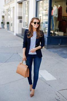 Smythe navy blazer and Tory Burch satchel.